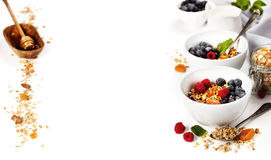 Healthy breakfast -  Homemade granola, honey, milk and berries Royalty Free Stock Photo