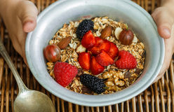Healthy Breakfast. Homemade granola with nuts, honey and fresh berries. Raspberries, strawberries, mulberries, gooseberries Stock Image