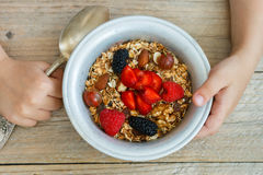 Healthy Breakfast. Homemade granola with nuts, honey and fresh berries. Raspberries, strawberries, mulberries, gooseberries Stock Images