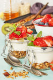 Healthy breakfast. Homemade yogurt parfait with granola, berries Stock Photography