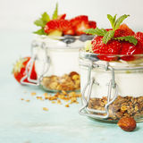 Healthy breakfast. Homemade yogurt parfait with granola, berries Stock Photos