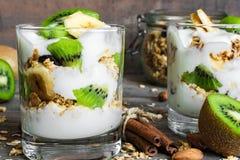 Healthy breakfast. homemade yogurt parfait with granola, kiwi fruit, banana Stock Image