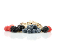 Healthy Breakfast II. Bright studio macro of healthy breakfast ingredients of muesli and fresh berries against a white background. Copy space Royalty Free Stock Photography