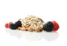 Healthy Breakfast Ingredients. Bright studio macro of healthy breakfast ingredients, muesli, fresh berries and nuts against a white background. Copy space royalty free stock image