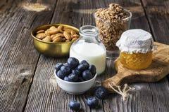 Healthy breakfast ingredients. Cereal, chocolate muesli, fresh blueberries Royalty Free Stock Images