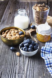 Healthy breakfast ingredients. Cereal, chocolate muesli, fresh blueberries Royalty Free Stock Photography