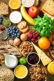 Healthy breakfast ingredients, food frame. Granola, egg, nuts, fruits, berries, toast, milk, yogurt, orange juice stock image