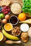 Healthy breakfast ingredients, food frame. Granola, egg, nuts, fruits, berries, toast, milk, yogurt, orange juice royalty free stock photos