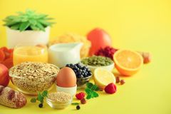 Healthy breakfast ingredients, food frame. Oat and corn flakes, eggs, nuts, fruits, berries, toast, milk, yogurt, orange, banana, stock photography