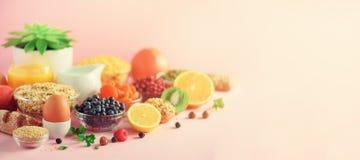 Healthy breakfast ingredients, food frame. Oat and corn flakes, eggs, nuts, fruits, berries, toast, milk, yogurt, orange, banana, royalty free stock photography