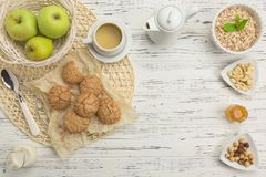 Healthy breakfast ingredients. Oatmeal and almond biscuits, nuts Stock Photo