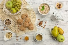 Healthy breakfast ingredients. Oatmeal and almond cookies, fruit stock photo