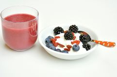 Healthy breakfast with juice , blueberry and blackberry Royalty Free Stock Photos