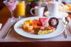 Healthy breakfast with juicy fruits and black Royalty Free Stock Photography