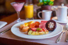 Healthy breakfast with juicy fruits and black Royalty Free Stock Photo