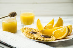 Healthy breakfast at a marble table with orange juice. read a newspaper Royalty Free Stock Images