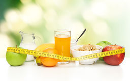 Healthy breakfast and measuring tape Royalty Free Stock Images