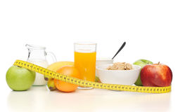 Healthy breakfast and measuring tape Royalty Free Stock Photo