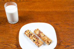 Healthy breakfast, milk, cereal bar Stock Photos