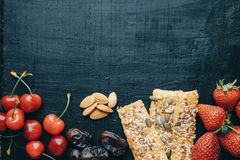 Healthy breakfast with milk, corn flakes, strawberries and cherries Stock Photo