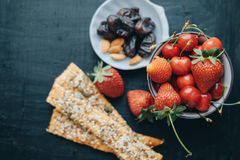 Healthy breakfast with milk, corn flakes, strawberries and cherries Royalty Free Stock Photo