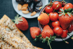 Healthy breakfast with milk, corn flakes, strawberries and cherries Royalty Free Stock Image