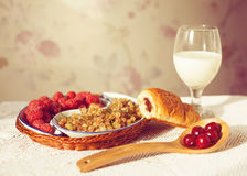 Healthy breakfast with milk and croissants. Fresh tasty berries. Stock Photos