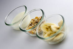 Healthy breakfast with milk, toasted muesli and banana slices Royalty Free Stock Image