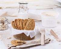 Healthy breakfast with milk and wholegrain cookies. Healthy breakfast with wholegrain cookies and bottles of milk over white wooden background royalty free stock image