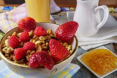 Muesli with strawberry and fresh juice. Royalty Free Stock Photos