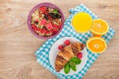 Healthy breakfast with muesli, berries, orange juice and croissa Royalty Free Stock Photos