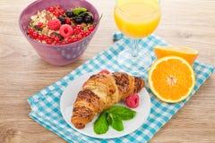 Healthy breakfast with muesli, berries, orange juice and croissa Stock Photos