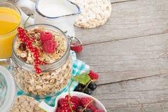 Healthy breakfast with muesli, berries, orange juice and milk Royalty Free Stock Image