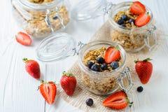 Healthy breakfast of muesli, berries. On white wood background Royalty Free Stock Images