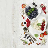 Healthy breakfast of muesli, berries with yogurt and seeds Stock Photo