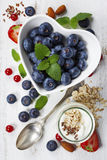 Healthy breakfast of muesli, berries with yogurt and seeds Royalty Free Stock Photography