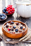Healthy breakfast with muesli and chocolate covered berries stock photos