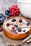 Healthy breakfast with muesli and chocolate covered berries stock photography