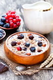 Healthy breakfast with muesli and chocolate covered berries stock images