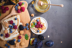 Healthy breakfast muesli and crepes with fresh berries and fruit Stock Photography