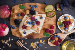Healthy breakfast muesli and crepes with fresh berries and fruit Royalty Free Stock Photography