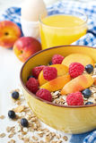 Healthy breakfast with muesli and fresh berries and fruits. On wooden background Stock Photos