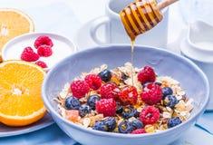 Healthy breakfast. Breakfast with muesli and fresh berries, honey, yogurt, orange on table.Healthy morning food. Health and diet concept Royalty Free Stock Photo