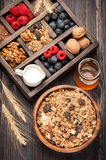 Healthy breakfast with muesli, granola. Honey, nuts, blueberries, raspberries, milk. Stock Photos