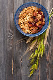 Healthy Breakfast. Muesli granola oatmeal with nuts, milk and dried fruits.  Top view. Stock Images