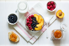 Healthy breakfast: muesli with honey, milk and fresh berries in a bowl Stock Photography