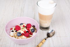 Healthy breakfast with muesli, milk, berries and coffee Stock Image