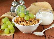 Healthy breakfast of muesli with milk and grapes Stock Image