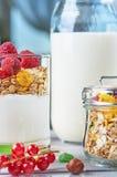 Healthy breakfast with muesli, milk, yogurt, fruit royalty free stock photos