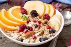 Healthy breakfast. Muesli with orange fruit, apple, pomegranate, Stock Photo